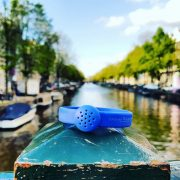 Electric blue rubber bracelet diffuser (boats in background)